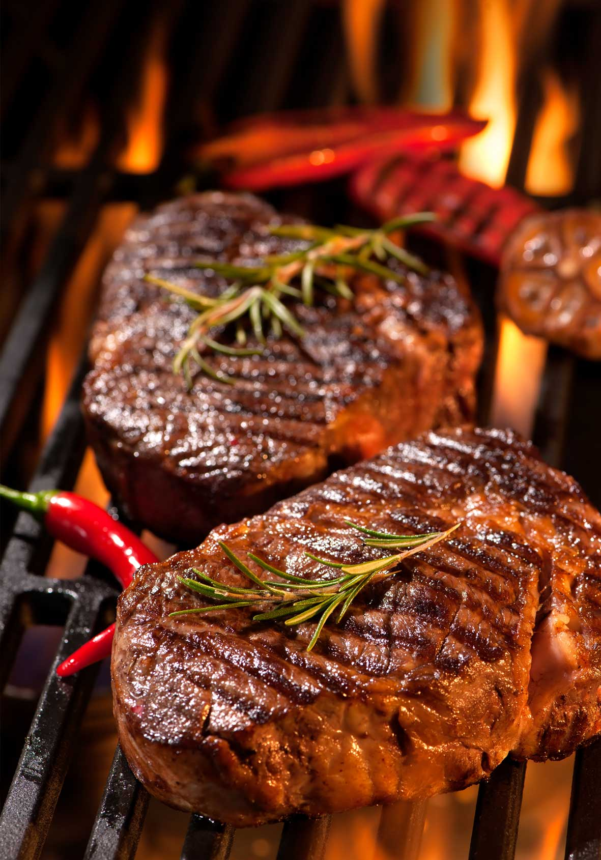 what is the difference between barbecuing and grilling | what is grilling | grilled steaks